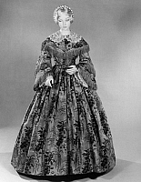0172845 © Granger - Historical Picture ArchiveFASHION: DRESS, c1855.   Brown and beige silk dress embroidered with flowers, American, c1855.