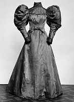 0172850 © Granger - Historical Picture ArchiveFASHION: DRESS, 1895.   Blue iridescent cotton and silk satin dress with leg-of-mutton style sleeves, American, 1895.
