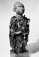 0114195 © Granger - Historical Picture ArchiveCONGO: FETISH FIGURE.   Bakongo tribe. Wood, paint, nails, cloth, beads, shells, twine, nuts. Height: 23 inches.