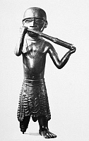 0260679 © Granger - Historical Picture ArchiveAFRICA: HORN PLAYER.   Brass figure of a horn player, made by the Edo people of Nigeria, Court of Benin, 1550-1680. Photograph, 20th century.