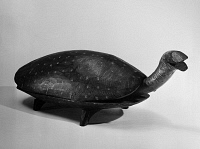 0172892 © Granger - Historical Picture ArchiveFOOTSTOOL, 19th CENTURY.   Carved wooden turtle footstool, American, 19th century.