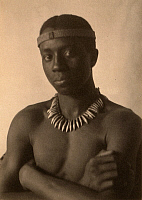 0268826 © Granger - Historical Picture ArchiveDAY: MAN, c1897.   Portrait of a young man wearing an African costume. Platinum print photograph by F. Holland Day, c1897.
