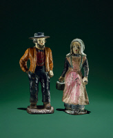 0409415 © Granger - Historical Picture ArchiveDOORSTOPS, c1870.   Cast iron doorstops depicting an Amish couple from Lancaster, Pennsylvania, c1870.