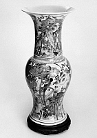 0122790 © Granger - Historical Picture ArchiveCHINA: PORCELAIN VASE.   Porcelain beaker vase decorated with scenes of flowers in a landscape. Probably Ching Dynasty, 17th-19th century.
