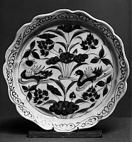 0122793 © Granger - Historical Picture ArchiveCHINA: PORCELAIN PLATE.   Blue and white porcelain plate with foliated rim, decorated with a depiction of mandarin ducks among lotus and other water plants. Diameter: 6 1/4 in. Yuan or early Ming Dynasty, 14th century.