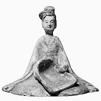 0122960 © Granger - Historical Picture ArchiveCHINA: TOMB FIGURE.   Earthenware tomb figure of a girl with a harvesting tool. Six Dynasties, 3rd-6th century A.D.