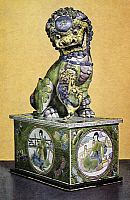 0123176 © Granger - Historical Picture ArchiveCHINA: LION ON PEDESTAL.   Porcelain figure of a Buddhist lion on a pedestal, decorated with famille verte enamels. Combined height: 15 1/4 in. K'ang Hsi period, Ching Dynasty, 1661-1722.