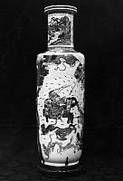 0123182 © Granger - Historical Picture ArchiveCHINA: PORCELAIN VASE.   Porcelain rouleau vase decorated in famille verte enamels, featuring a depiction of warriors attacking an armored demon mounted on a lion. K'ang Hsi period, Ching Dynasty, 1661-1722.