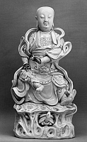 0123275 © Granger - Historical Picture ArchiveCHINA: TAOIST DEITY.   Glazed white porcelain figure of Xuan Wu, the 'Dark Warrior,' Taoist guardian of the north. Dehua ware, Fujian province. Late K'ang Hsi period, Ching Dynasty, early 18th century.