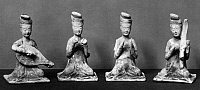 0123379 © Granger - Historical Picture ArchiveCHINA: TOMB FIGURES.   A set of four earthenware tomb figures of court musicians. T'ang Dynasty, 618-907 A.D.