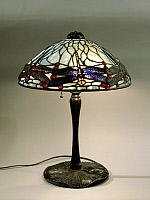 0363142 © Granger - Historical Picture ArchiveDECORATIVE ARTS.   Dragonfly Lamp with opal glass polychrome shade in Favrile glass and glass jewel cabochon applications, Clara Driscoll, Tiffany Studios, piece number 1585, and United States of America, 20th century.Full credit: De Agostini / G. Dagli Orti / Granger, NYC -- All rights reserved.