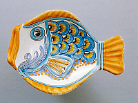 0422853 © Granger - Historical Picture ArchiveDECORATIVE ARTS.   Small plate in shape of fish with yellow fins and tail, decorated with peacock's tail, Ceramiche Dell'Aquila manufacture, Caltagirone, Sicily, Italy, 20th century Full credit: De Agostini / A. Dagli Orti / Granger, NYC -- All Rights Reserved.