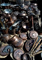 0423169 © Granger - Historical Picture ArchiveDECORATIVE ARTS.   Handmade copper containers at market stall, Piazza del Duomo, L'Aquila, Abruzzo, Italy Full credit: De Agostini / S. Vannini / Granger, NYC -- All Rights Reserved.