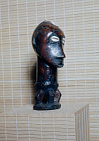 0423306 © Granger - Historical Picture ArchiveDECORATIVE ARTS.   Wood anthropomorphic statuette with shells as eyes, African art, Democratic Republic of the Congo, Africa Full credit: De Agostini Picture Library / Granger, NYC -- All Rights Reserved.