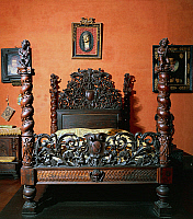 0423943 © Granger - Historical Picture ArchiveDECORATIVE ARTS.   Carved walnut Emilian bed with Sanvitales coat of arms, Sanvitale Castle, Fontanellato, Emilia Romagna, Italy, 17th century Full credit: De Agostini / A. De Gregorio / Granger, NYC -- All Rights Reserved.