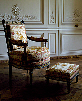 0425309 © Granger - Historical Picture ArchiveDECORATIVE ARTS.   Louis XVI style armchair and footstool, Queen's sitting room, Petit Trianon, Palace of Versailles, Ile de France, France, 18th century Full credit: De Agostini / G. Dagli Orti / Granger, NYC -- All Rights Reserved.