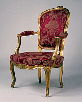 0427188 © Granger - Historical Picture ArchiveDECORATIVE ARTS.   Louis XV style carved and gilt beech cabriolet armchair, France, 18th century Full credit: De Agostini / J. M. Zuber / Granger, NYC -- All Rights Reserved.
