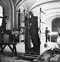 0096377 © Granger - Historical Picture ArchiveLOUVRE: VENUS DE MILO.   The Venus de Milo encased in a wooden crate, which has been placed on rollers, prior to being moved at the Louvre Museum in Paris, France, as a precaution following the outbreak of World War II, September 1939. Photographed by Laure Albin-Guillot.