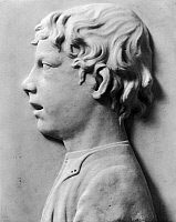0165730 © Granger - Historical Picture ArchiveDELLA ROBBIA: SINGING BOY.   'Head of a Singing Boy.' Marble relief by Luca della Robbia, 15th century.