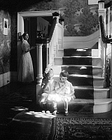 0260478 © Granger - Historical Picture ArchiveKASEBIER: LOLLIPOPS, 1910.   Mina Turner and her cousin Elizabeth eating lollipops on the stairs in a house in Waban, Massachusetts. Photograph by Gertrude Kasebier, 1910.