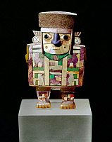 0260212 © Granger - Historical Picture ArchivePERU: WARI FIGURE.   Wood figure of a dignitary with inlaid shell, turquoise, and lapis lazuli, by the Wari culture of the southern coast of Peru, 500-1000 A.D.