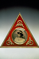 0260706 © Granger - Historical Picture ArchiveFABERGE FRAME, 1896-1908.   Faberge triangular picture frame, with silver gilt, silver, enamel, holly and glass, 1896-1908.