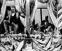 0121788 © Granger - Historical Picture ArchiveBIRTH OF A NATION, 1915.   John Wilkes Booth jumps to the stage after having assassinated President Abraham Lincoln at Ford's Theatre in Washington D. C. Scene from D.W. Griffith's film 'Birth of a Nation,' 1915.