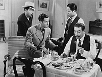 0131891 © Granger - Historical Picture ArchiveFILM: CHARLIE CHAN, 1937.   Warner Oland (seated, right) in the title role of the film 'Charlie Chan on Broadway,' with Keye Luke (standing, right) as his 'Number One Son,' 1937.