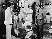 0131898 © Granger - Historical Picture ArchiveFILM: CHARLIE CHAN, 1935.   Warner Oland (right) in the title role of the film 'Charlie Chan in Egypt,' with Stepin Fetchit (kneeling) as Snowshoes, 1935.