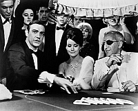 0120874 © Granger - Historical Picture ArchiveTHUNDERBALL, 1965.   Left to right: Sean Connery as James Bond, Claudine Auger as Domino, and Adolfo Celi as Emilio Largo, gambling in a casino in a scene from the 1965 film 'Thunderball,' based on the Ian Fleming novel of the same name.