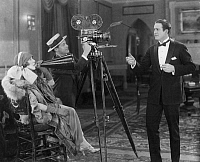 0046072 © Granger - Historical Picture ArchiveMOTION PICTURE, 1924.   Lady Diana Manners, English actress, directing a scene at the Fox Film Company studio in New York City, 1924.