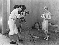 0050085 © Granger - Historical Picture ArchiveMOVIE CAMERA, 1920s.   An actress poses during the filming of a motion picture, 1920s.