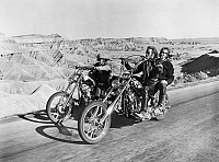 0120986 © Granger - Historical Picture ArchiveFILM: EASY RIDER, 1969.   Peter Fonda (right foreground) and Dennis Hopper (left) on the road in the American Southwest in 'Easy Rider,' directed by Dennis Hopper, 1969. Riding with Fonda is Luke Askew.