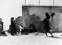 0120888 © Granger - Historical Picture ArchiveFELLINI: 8 1/2, 1963.   Saraghina and the boys on the beach at Rimini in a scene from Federico Fellini's film '8 1/2,' 1963.