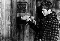 0120962 © Granger - Historical Picture ArchiveFILM: 400 BLOWS, 1959.   Jean-Pierre Léaud as young Antoine Doinel, under arrest in 'The 400 Blows' directed by François   Truffaut, 1959.