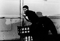 0120965 © Granger - Historical Picture ArchiveFILM: 400 BLOWS, 1959.   Jean-Pierre Leaud as the young Antoine Doinel stealing a bottle of milk in 'The 400 Blows' directed by François Truffaut, 1959.