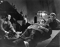 0014038 © Granger - Historical Picture ArchiveSON OF FRANKENSTEIN, 1939.   Basil Rathbone as Dr. Frankenstein, Boris Karloff as the Monster, and Bela Lugosi assisting.