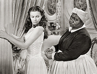0005505 © Granger - Historical Picture ArchiveGONE WITH THE WIND, 1939.   Hattie McDaniel assists Vivien Leigh while offering some unwelcomed advice.
