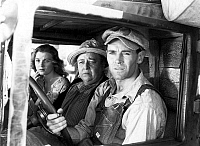 0000442 © Granger - Historical Picture ArchiveTHE GRAPES OF WRATH (1940).   Starring Henry Fonda, far right.