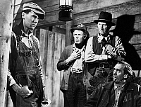 0000443 © Granger - Historical Picture ArchiveGRAPES OF WRATH, 1940.   Henry Fonda (left), as Tom Joad, in a scene from the film.