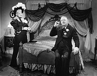 0088442 © Granger - Historical Picture ArchiveMY LITTLE CHICKADEE, 1940.   Film still with Mae West as Flower Belle Lee and W.C. Fields as Twillie.