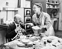 0030662 © Granger - Historical Picture ArchiveFILM STILL: EATING & DRINKING.   Actors Lucien Littlefield and Louise Fazenda.
