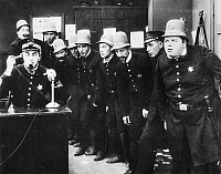 0049572 © Granger - Historical Picture ArchiveKEYSTONE KOPS.   A scene from 'In the Clutches of a Gang,' c1913.   Fatty Arbuckle is at the extreme right.