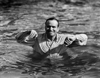 0072125 © Granger - Historical Picture ArchiveSILENT STILL: BATHING.   Douglas Fairbanks swimming in a silent film. Film still, 1920.