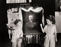 0072416 © Granger - Historical Picture ArchiveSILENT STILL: CHILDREN.   Jane (left) and Katherine Lee threatening to give a pie in the face to a painting of Kaiser Wilhelm II of Germany. Still from the 1918 motion picture 'Swat the Spy.'