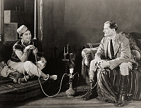 0073822 © Granger - Historical Picture ArchiveSILENT FILM STILL: SMOKING.  'Without Benefit of Clergy,' 1921.