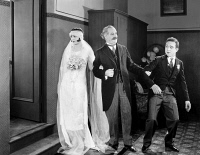 0074352 © Granger - Historical Picture ArchiveHIS MARRIAGE WOW, 1925.   Natalie Kingston, William McCall, and Harry Langdon.