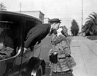 0085105 © Granger - Historical Picture ArchiveSILENT FILM STILL: KISSING.   Buster Keaton and Virginia Fox in 'The Goat,' 1921.