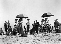 0123213 © Granger - Historical Picture ArchiveFILMING ON LOCATION, 1923.   Director James Cruze, in checkered jacket, crew and actors ready to film a scene in Utah for 'The Covered Wagon, 1923.