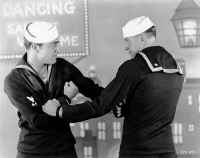 0623641 © Granger - Historical Picture ArchiveTHE FLEET'S IN, 1928.   American silent film. Two sailors fist fighting in 'The Fleet's In' from Paramount Pictures. Film still, 1928.